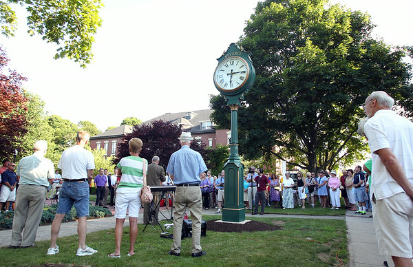 A few hundred people gathered on Beverly Common on Wednesday evening for the dedication of a large clock in honor of former Mayor Bill Scanlon's 16 years of service to the City of Beverly. DAVID LE/Staff photo. 7/9/14.