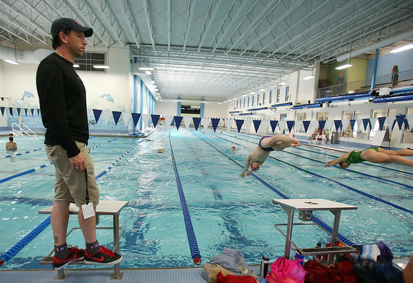 "Chris Morgan is the new YNS Sharks Competitive Aquatics Director. Morgan gives his team ""Go"" commands as they practice starts on Friday afternoon. He and his team will be leaving on Saturday to go to Nationals. DAVID LE/Staff photo. 7/25/14."