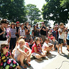 Hundreds of people gathered around the bandstand for the Lobster Roll Eating Contest during the first Salem Willows Seafood Festival on Saturday afternoon. DAVID LE/Staff photo. 7/12/14.