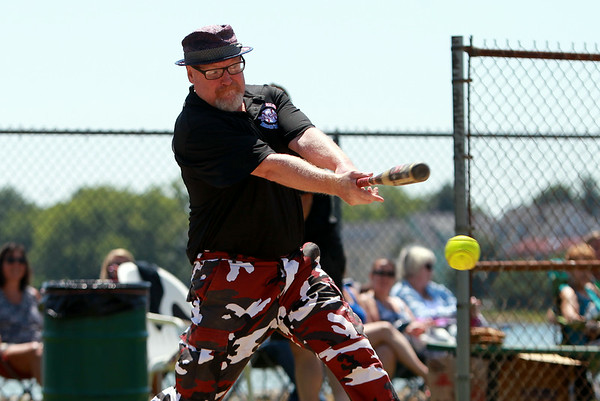 Salem City Councilor Bill Legault makes contact in a charity softball game between Salem and Peabody City officials on Saturday morning. DAVID LE/Staff photo. 7/12/14.