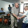 KEN YUSZKUS/Staff photo. Charles Wallace and Joan Wollman meet in the renovated hallway which has new paint and new carpeting. The Ray Novak Trio plays in the background during the post construction festivities at Turtle Creek in Beverly.  7/9/14