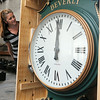 KEN YUSZKUS/Staff photo. Department of Public Services administrative asisstant Tracy Reardon looks over the clock that will be installed on Beverly Common next week in honor of former Mayor Bill Scanlon.  7/3/14