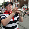 KEN YUSZKUS/Staff photo. Jenna Johnson plays with the Arbella Drum & Bugle Corps along West Street in the Beverly Farms Horribles Parade. 7/4/14