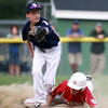 Hamilton-Wenham shortstop Cooper McGrath (10) stretches to receive the ball but isn't in time to retire sliding Barnstable runner Brian Frieh (14) on a force play. The Generals lost to Barnstable 12-1 in a shortened 4 inning contest on Friday evening at Harry Ball Field in Beverly. DAVID LE/Staff photo. 7/25/14.