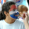 KEN YUSZKUS/Staff photo. Breanna Brown, 12, has her face painted at the July 4th activities at Peabody's Welch School playground.  7/4/14