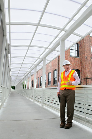 KEN YUSZKUS/Staff photo. Project manager George Doherty is in the new walkway for the  Beverly MBTA parking garage which is under construction.   7/3/14