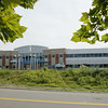 KEN YUSZKUS/Staff photo.  New England Academy's new school building is under construction on Cherry Hill Drive in Beverly.   7/17/14