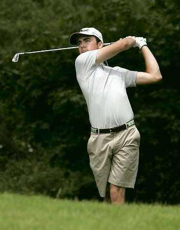 KEN YUSZKUS/Staff photo. Matthew Bullock of Kernwood Country Club tees off the 8th tee on the first day of play at the 105th Massachusetts Amateur Championship (golf) at Kernwood Country Club in Salem.   7/14/14