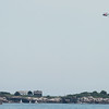 A Coast Guard chopper patrols the skies above Children's Island in Marblehead on Tuesday afternoon as the search for a missing diver took place. DAVID LE/Staff photo. 7/22/14.