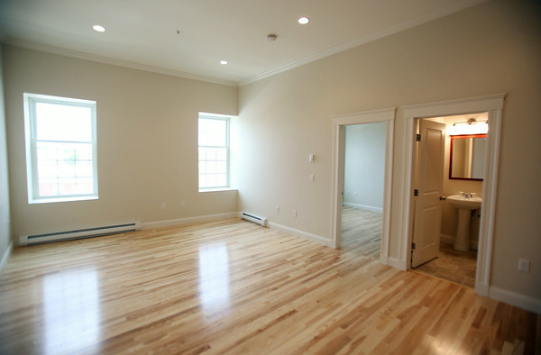 Open living room area. The ten units are made up of eight 1-bedroom apartments and two studio apartments, and replaced the old Masonic Lodge which was vacant for over twenty years. DAVID LE/Staff photo. 7/31/14.