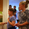 Seven-year-old Riley Fessenden, left, with her sister Meghan, 8, smile as they walk into their new playroom. With the help of 75 volunteers, a nonprofit called Special Spaces Boston, did a three-day makeover of the downstairs playroom for Riley Fessenden and her brothers and sisters. DAVID LE/Staff photo. 7/26/14.