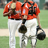 KEN YUSZKUS/Staff photo. Beverly's pitcher Matt Miller speaks with catcher Matt Ploszay on the mound during the Williamsport Little League District 15 tournament game against Hamilton Wenham.  7/7/14