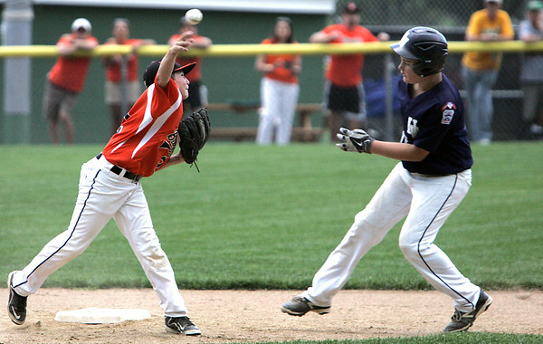 KEN YUSZKUS/Staff photo. Beverly's 2nd baseman Brayden Clark throws to 1st after tagging Hamilton Wenham's Aidan Cann out at 2nd during the Williamsport Little League District 15 tournament game against Hamilton-Wenham.  7/7/14
