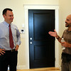 Peabody Mayor Ted Bettencourt, left, talks with Norman Lee, of Northeast Contractor Solutions Inc., inside one of the ten new apartment units at 17 Main Street in Peabody. The ten units are made up of eight 1-bedroom apartments and two studio apartments, and replaced the old Masonic Lodge which was vacant for over twenty years. DAVID LE/Staff photo. 7/31/14.