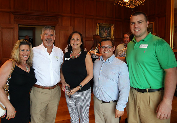 From left, Jill Betit and Ed Soul, of the Beverly Athletic Club, Robin Foster, of the Greater Beverly Chamber of Commerce, Medley Long, of Medley Sites, and Scott Gibney, of the Salem Chamber of Commerce, at a Multi-Chamber Networking event held at the Misselwood Estate at Endicott College on Wednesday evening. DAVID LE/Staff photo. 7/16/14.