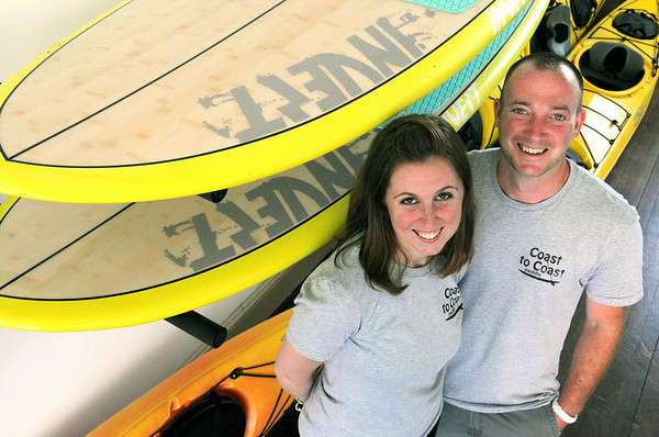 KEN YUSZKUS/Staff photo. Ashley Skomurski and Aaron Mearns are the owners of Coast to Coast Paddle in Beverly which just opened.   7/3/14