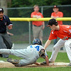 Beverly first baseman Robby Black swipes a tag on Danvers American pitcher Kevin Rooney as he slides safely back into first base on Tuesday evening at Harry Ball Field in Beverly. DAVID LE/Staff photo. 7/8/14.