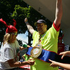 Peabody resident Joseph Kameese gets crowned as the champion of the Lobster Roll Eating Contest during the first Salem Willows Seafood Festival on Saturday afternoon. DAVID LE/Staff photo. 7/12/14.