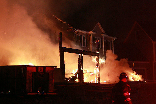 Firefighters worked hard to knock down a 3-alarm blaze on Folger Ave in Beverly on Sunday evening. DAVID LE/Staff photo. 7/13/14.
