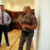 Norman Lee, of Northeast Contractor Solutions Inc., right, talks about the advantages of the visual intercom systems inside one of the new apartment units located at 17 Main Street to Peabody Mayor Ted Bettencourt. The ten units are made up of eight 1-bedroom apartments and two studio apartments, and replaced the old Masonic Lodge which was vacant for over twenty years. DAVID LE/Staff photo. 7/31/14.