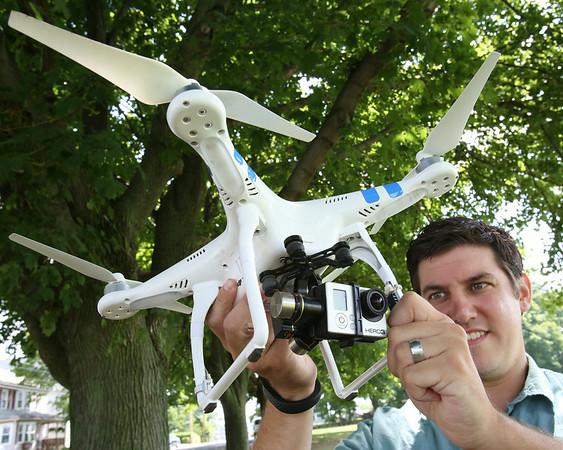 KEN YUSZKUS/Staff photo. Brian Gravel of GraVoc Associates demonstrates their drone used to take aerial photos for websites.   7/14/14
