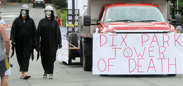 KEN YUSZKUS/Staff photo. The end of the Beverly Farms Horribles Parade is marked by the Dix Park Tower of Death float. 7/4/14