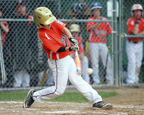Beverly shortstop Brayden Clark lines a hit off Danvers American starting pitcher Kevin Rooney on Tuesday evening at Harry Ball Field in Beverly. DAVID LE/Staff photo. 7/8/14.
