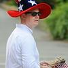 KEN YUSZKUS/Staff photo. Brett Schetzsle wears an appropriate hat during the Beverly Farms Horribles Parade. 7/4/14