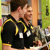 Boston Bruins prospects Kyle Baun, right, and Peter Cehlarik, ask trivia questions for Bruins prizes at Peabody Institute Library on Friday afternoon. DAVID LE/Staff photo. 7/11/14.