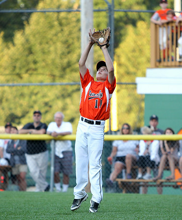 Beverly right fielder Bryce Kopcak hauls in a shallow fly ball to retire a Hamilton-Wenham batter on Thursday evening at Harry Ball Field in Beverly. DAVID LE/Staff photo. 7/10/14.