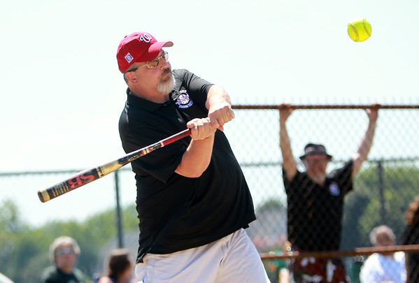 Salem Ward 5 City Councillor Josh Turiel keeps his eyes on the ball while playing in a charity softball game between Salem and Peabody City officials on Saturday morning. DAVID LE/Staff photo. 7/12/14.
