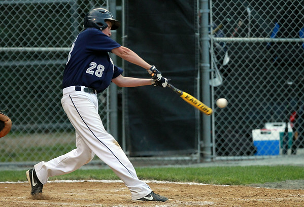 Hamilton-Wenham first baseman Will Jones launches a solo home run against Barnstable. The Generals lost to Barnstable 12-1 in a shortened 4 inning contest on Friday evening at Harry Ball Field in Beverly. DAVID LE/Staff photo. 7/25/14.