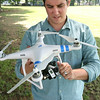 KEN YUSZKUS/Staff photo. Brian Gravel of GraVoc Associates demonstrates their drone used to take aerial photos for websites.   7/14/14