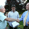 Former Beverly Mayor Bill Scanlon shakes hands with Matt and Roy Gelineau, following a short ceremony to dedicate a clock on Beverly Common in honor of Scanlon's 16 years of service to the City of Beverly. DAVID LE/Staff photo. 7/9/14.