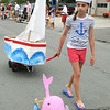 KEN YUSZKUS/Staff photo. Ella Ricci pulls a sailboat along West Street as part of the Beverly Farms Horribles Parade. 7/4/14