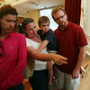 Karen Paluzzi, left, and Kristine, Ethan, 5, and David Pagano, all of Beverly, look at plans for the proposed Brimbal Ave renovations at the Beverly Senior Center on Thursday evening. DAVID LE/Staff photo. 7/24/14.