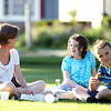Victoria Hackett, and Emily, 12, and William Baumoel, 10, of Beverly, enjoy a pizza picnic while listening to Quintessential Brass, on Beverly Common on Thursday evening. DAVID LE/Staff photo. 7/10/14.