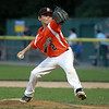 Beverly relief pitcher Brayden Clark fires a pitch against Danvers American on Tuesday evening at Harry Ball Field in Beverly. DAVID LE/Staff photo. 7/8/14.