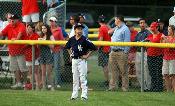 Hamilton-Wenham center fielder Lenny Dolan stands with his hands on his hips in frustration after another Barnstable home run left the yard. The Generals lost to Barnstable 12-1 in a shortened 4 inning contest on Friday evening at Harry Ball Field in Beverly. DAVID LE/Staff photo. 7/25/14.