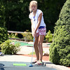 Ten-year-old Lauren Stammnitz, of Marblehead, closely watches her putt while playing mini golf at Castle Creek in Salem on Tuesday afternoon. DAVID LE/Staff photo. 7/29/14.