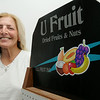KEN YUSZKUS/Staff photo.  Anne Counihan of All Fruit Inc. in Peabody.   7/7/14
