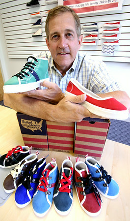 KEN YUSZKUS/Staff photo.  General Manager Art Rogers of Danvers-based United Shoes of America launches its shoe line for toddlers and kids. 7/18/14