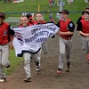 RYAN HUTTON/ Staff photo<br /> The Salem Little League team takes a victory lap around the field with their championship banner after downing Saugus American 18-8 in the bottom of the fourth inning of Wednesday's District 16 championship game.