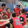 RYAN HUTTON/ Staff photo<br /> Salem's William Foglietta, center, is congratulated by his teammates at home plate after he hit the winning home run in the bottom of the fourth inning of Wednesday's District 16 Championship game against Saugus American. Salem won 18-8 in the fourth inning.
