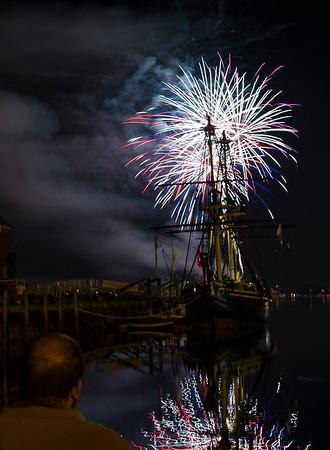 AMANDA SABGA/ Staff photo <br /> <br /> Fireworks explode over Derby Harbor as Salem celebrated Independence Day at the Maritime National Historic Site.<br /> 7/4/15