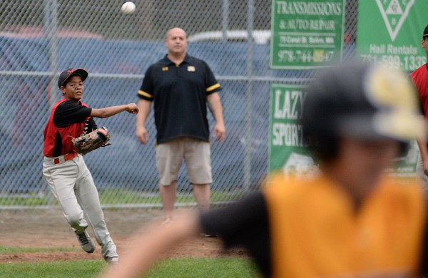 RYAN HUTTON/ Staff photo<br /> Salem's Guillermo Pimentel fires the ball to first make the out at the top of the fourth inning of Wednesday's District 16 Championship game against Saugus American. Salem won 18-8 in the fourth inning.