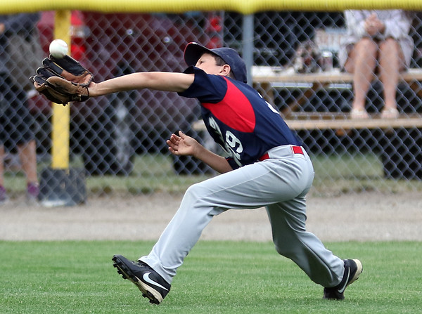 DAVID LE/Staff photo. Masco left fielder Jack Mitchell makes a lunging catch in short left field to save a run against Beverly. 7/8/16.