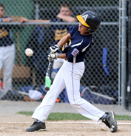 DAVID LE/Staff photo. Andover National leadoff hitter Brian Gibson lines a hit against Beverly. 7/21/16.