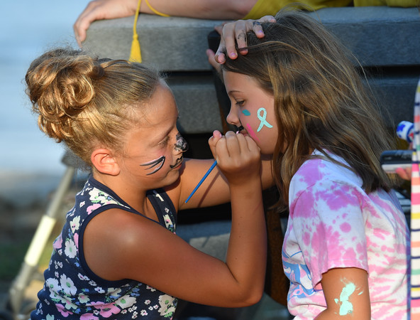 Taylor Burnett 11 of Beverly (l) paints the face of Julianna Galeota of Beverly during thr Riley Rocks event at Lynch Park.<br /> <br /> Photo by joebrownphotos.com