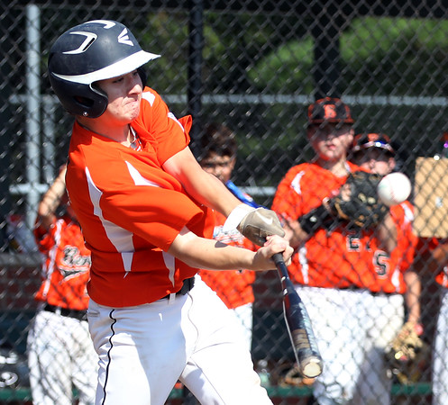 DAVID LE/Staff photo. Beverly slugger Joey Loreti launches a homer against Fairhaven/Acushnet on Friday afternoon. 7/29/16.